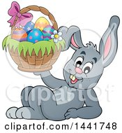 Clipart Of A Happy Gray Easter Bunny Rabbit Resting And Holding A Basket Royalty Free Vector Illustration