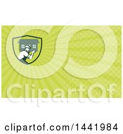 Clipart Of A Retro Male Mover Carrying A House And Green Rays Background Or Business Card Design Royalty Free Illustration