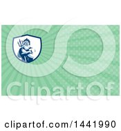 Retro Man Triton Mythological God Holding A Trident In Folded Arms Inside A White And Blue Shield And Green Rays Background Or Business Card Design