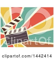 Clipart Of A Retro Flat Styled Clapperboard Over Rays Royalty Free Vector Illustration by BNP Design Studio