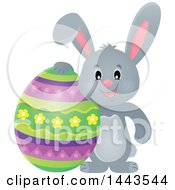 Gray Easter Bunny Rabbit With A Decorated Egg
