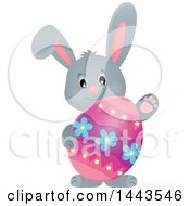 Clipart Of A Gray Easter Bunny Rabbit Holding A Decorated Egg Royalty Free Vector Illustration