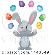 Clipart Of A Gray Easter Bunny Rabbit Juggling Decorated Eggs Royalty Free Vector Illustration