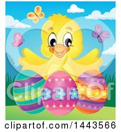 Happy Yellow Chick With Easter Eggs And Butterflies On A Spring Day