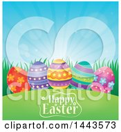 Decorated Eggs In Grass Over Happy Easter Text And Sunshine