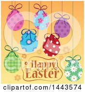 Happy Easter Greeting With Sunspended Decorated Eggs Over Orange