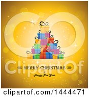 Clipart Of A Colorful Stack Of Gifts Over A Merry Christmas And Happy New Year Text On A Sparkly Golden Background Royalty Free Vector Illustration by ColorMagic