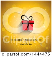 Clipart Of A Merry Christmas And Happy New Year Greeting With A Red Gift On A Golden Background Royalty Free Vector Illustration by ColorMagic