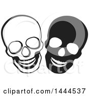 Clipart Of Black And White Laughing Skulls Royalty Free Vector Illustration