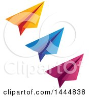 Trio Of Orange Blue And Pink Paper Airplanes
