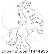 Clipart Of A Cartoon Black And White Lineart Cute Unicorn Rearing Royalty Free Vector Illustration by Alex Bannykh