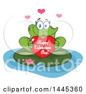 Cartoon Female Frog Holding A Red Happy Valentines Day Love Heart On A Lily Pad