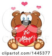 Clipart Of A Cartoon Teddy Bear Holding A Be Mine Valentine Love Heart Royalty Free Vector Illustration
