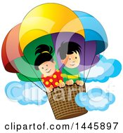 Clipart Of A Happy Boy And Girl In A Colorful Hot Air Balloon Royalty Free Vector Illustration