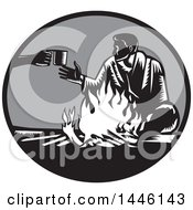 Clipart Of A Retro Woodcut Man Accepting A Cup Of Coffee By A Campfire Royalty Free Vector Illustration