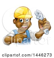 Clipart Of A Cartoon Happy Black Male Plumber Holding An Adjustable Wrench And Pointing Royalty Free Vector Illustration