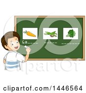 Happy Brunette White School Boy Writing The Names Under Vegetables On A Chalkboard
