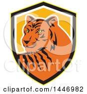 Clipart Of A Retro Tiger Mascot In A Yellow Black White And Orange Shield Royalty Free Vector Illustration