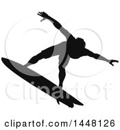 Black Silhouetted Man Surfing