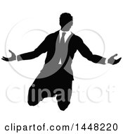 Clipart Of A Black And White Silhouetted Business Man Kneeling And Worshipping Royalty Free Vector Illustration