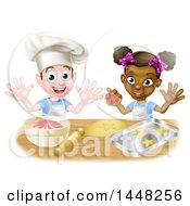 Happy White Boy And Black Girl Making Making Star Cookies And Frosting