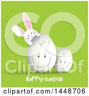 Happy Easter Greeting With A Cute White Bunny Rabbit And Smiling Eggs On Green