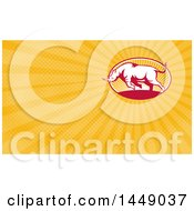 Clipart Of A Retro Charging Rhino And Orange Rays Background Or Business Card Design Royalty Free Illustration by patrimonio