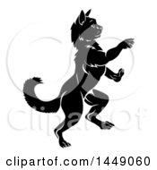 Clipart Graphic Of A Black And White Silhouetted Heraldic Rearing Rampant Cat Royalty Free Vector Illustration