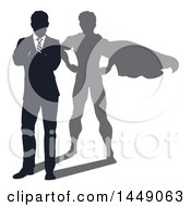 Silhouetted Business Man Standing With Folded Arms And A Super Hero Shadow