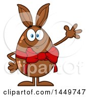 Clipart Graphic Of A Cartoon Bunny Eared Chocolate Easter Egg Mascot Character Waving Royalty Free Vector Illustration by Hit Toon