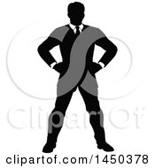 Black And White Silhouetted Business Man Standing With Hands On His Hips
