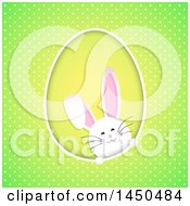 Clipart Graphic Of A White Easter Bunny Rabbit In An Egg Shaped Frame On Green Polka Dots Royalty Free Vector Illustration
