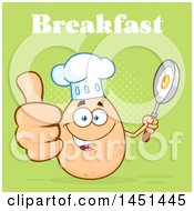 Cartoon Egg Chef Mascot Character Holding A Frying Pan And Giving A Thumb Up Under Breakfast Text Over Green