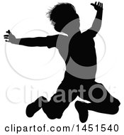 Black Silhouetted Little Boy Jumping