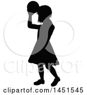 Black Silhouetted Little Girl Throwing A Ball