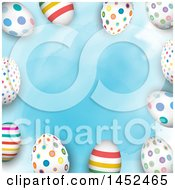 Clipart Of A Border Of Colorful Patterned Easter Eggs Over Blue Watercolor Royalty Free Vector Illustration by KJ Pargeter
