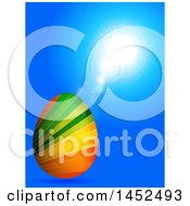 3d Colorful Striped Easter Egg Over Blue With Flares