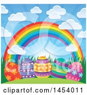 Sunny Sky With Clouds And A Rainbow Over Decorated Easter Eggs