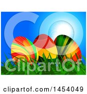 Trio Of 3d Colorful Striped Easter Eggs In Grass Against Blue Sky