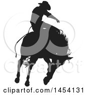Poster, Art Print Of Black Silhouetted Horseback Rodeo Cowboy On A Bucking Bronco