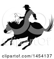 Clipart Graphic Of A Black Silhouetted Horseback Rodeo Cowboy On A Bronco Royalty Free Vector Illustration