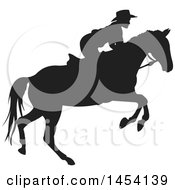 Clipart Graphic Of A Black Silhouetted Horseback Cowboy Royalty Free Vector Illustration