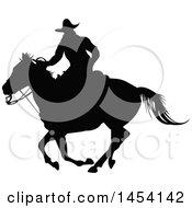 Poster, Art Print Of Black Silhouetted Horseback Cowboy