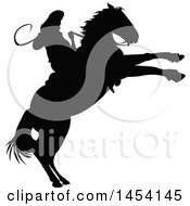 Clipart Graphic Of A Black Silhouetted Horseback Rodeo Cowboy On A Bucking Bronco Royalty Free Vector Illustration