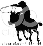 Clipart Graphic Of A Black Silhouetted Horseback Rancher Cowboy Swinging A Lasso Royalty Free Vector Illustration by Pushkin