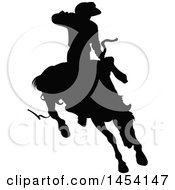 Black Silhouetted Horseback Rodeo Cowboy On A Bucking Bronco