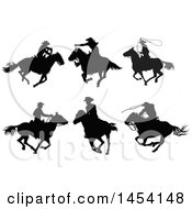 Clipart Graphic Of Black Silhouetted Horseback Cowboys Royalty Free Vector Illustration
