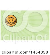 Clipart Of A Retro Cow Head And Laurel Branches In A Black And Orange Circle And Green Rays Background Or Business Card Design Royalty Free Illustration