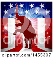 Clipart Of A Red Silhouette Of A Rearing Republican Elephant Over An American Flag Themed Burst Royalty Free Vector Illustration