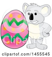 Clipart Of A Koala Bear School Mascot Character With An Easter Egg Royalty Free Vector Illustration